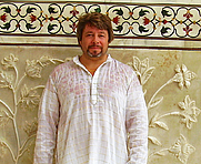 Author photo. Teacher and author Matthew Heines demonstrates humidity at the Taj Mahal