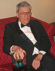 Author photo. James Edwin Gunn, SF author,<br> at the 2006 Nebula Awards<br> held in New York City, 2007 <br>Copyright © 2007 <a href=&quot;http://ronhogan.tumblr.com&quot;>Ron Hogan</a>