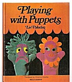 Playing with puppets by Lis Paludan