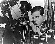 Author photo. Frank Capra cuts Army film as a <br>Signal Corps Reserve major during World War II. <br>This photo taken circa 1943. <br>(Public domain ; Wikipedia Commons)