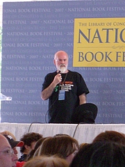 """Author photo. Terry Pratchett At the National Book Festival in Washington DC. By Andrew Kuchling - <a href=""""https://www.flickr.com/photos/akuchling/1460139562/in/photostream/"""" rel=""""nofollow"""" target=""""_top"""">https://www.flickr.com/photos/akuchling/1460139562/in/photostream/</a>, CC BY-SA 2.0, <a href=""""https://commons.wikimedia.org/w/index.php?curid=33740483"""" rel=""""nofollow"""" target=""""_top"""">https://commons.wikimedia.org/w/index.php?curid=33740483</a>"""