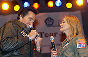 Author photo. Wayne Newton, Chairman of the USO Celebrity Circle and Bo Derek perform for Aviano Air Base spectators at the USO Holiday Tour 2001 show.