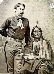 Author photo. public domain W.P. Clark standing Little Hawk seated