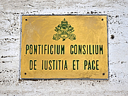 Author photo. Plaque of the Pontifical Council for Justice and Peace