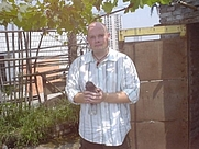 Author photo. Taken by Chris Rettstatt, on a rooftop garden in Chongqing, China.