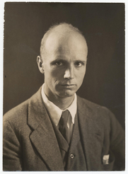 """Author photo. Kent wearing a coat and vest, annotated on reverse: """"Rockwell Kent, author of """"Wilderness"""", Putnam"""", photographer unknown.  Kent, Rockwell, 1882-1971"""