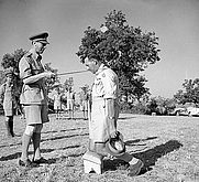 Author photo. King George VI knights Gen. Oliver Leese in the field, July 29, 1944 (Imperial War Museum collections)