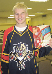 "Author photo. Zachary Hyman holding a copy of his first book, ""Hockey Hero"". (from yahoo sports)"