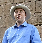 Author photo. Andrew Chugg in front of an ancient wall in the Shallalat Gardens in Alexandria, March 2008