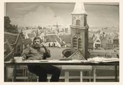 """Author photo. Willem G. van de Hulst Jr. in front of a decor piece made by him for the film """"Ik zie, ik zie""""."""