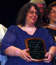 Author photo. Wen Spencer, accepting the Campbell Award at Torcon 3, the World Science Fiction Convention (Worldcon). Photo taken at the Hugo Award ceremony. Photo by David Brukman Date30 August 2003