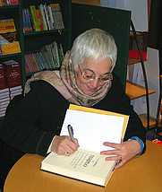 Author photo. Toti Martínez de Lezea (born in Vitoria, 1949) Spanish writer, in Basque and Spanish languages, signing a copy of her novel A la sombra del tiempo at a bookshop in Bilbao. By Javier Mediavilla Ezquibela - Own work, CC BY 2.5, <a href=&quot;https://commons.wikimedia.org/w/index.php?curid=1539175&quot; rel=&quot;nofollow&quot; target=&quot;_top&quot;>https://commons.wikimedia.org/w/index.php?curid=1539175</a>