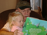 Author photo. Here I am reading a book to my granddaughter Ashtyn.