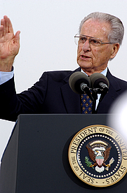 Author photo. Jerry Coleman, World War II veteran and commentator for the San Diego Padres baseball team, delivers opening remarks for a ceremony commemorating the 60th anniversary of the allied victory over Japan (VJ Day) during World War II.