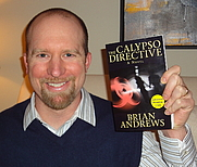 Author photo. Brian with the ARC (advanced reading copy) of Calypso Directive