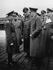 Author photo. Hitler's interpreter, <a href=&quot;http://en.wikipedia.org/wiki/Paul_Schmidt&quot;>Dr. Paul Schmidt</a> (center, in leather coat), translates for Hitler and Romanian dictator Ion Antonescu (at far left): National Archives and Records Administration (ushmm.org)