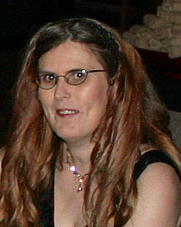 Author photo. A picture of me a few years ago....before I cut my locks. And yes, I donated them.