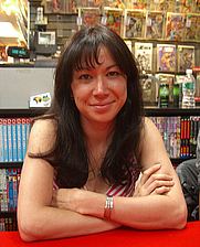 Author photo. Christine Norrie at a signing of the anthology Secret Identities at Midtown Comics Times Square on May 23, 2009. Photo by Nightscream.