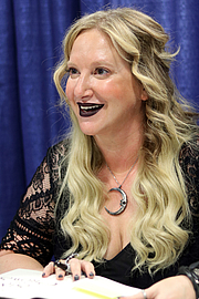 """Author photo. Leigh Bardugo at the 2018 U.S. National Book Festival By Fuzheado - Own work, CC BY-SA 4.0, <a href=""""https://commons.wikimedia.org/w/index.php?curid=72309615"""" rel=""""nofollow"""" target=""""_top"""">https://commons.wikimedia.org/w/index.php?curid=72309615</a>"""