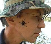 Author photo. Markku A. Huttunen with a Fishing Spider (aka Raft Spider or raitarantuli or Dolomedes fimbriatus) on his face during the 2006 Field Course in Ecology at Mekrijärvi, Ilomantsi, Eastern Finland. - Photo Saija Porramo 8. August 2006