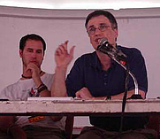 Author photo. Stephen Rosskamm Shalom (right) at World Social Forum 3, Porto Alegre, Brazil, 2003 (courtesy of <a href=&quot;http://www.zmag.org/photo7.htm&quot;>ZNet</a>)