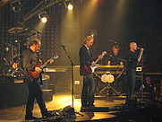 """Author photo. Genesis performing """"Carpet Crawlers"""" in Pittsburgh, Pennsylvania, US, on their 2007 Turn It On Again tour. [source: Andrew Bossi via Wikipedia]"""