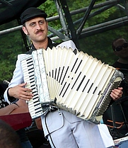 Author photo. Crop of Franz Nicolay playing the accordion with the The Hold Steady