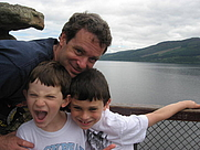 Author photo. Stephen M. Miller and his two sons in Scotland