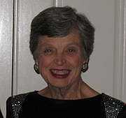 Author photo. Jamie Gilson smiles in New Year's Eve finery in 2007./Wikipedia user Aunt Petunia