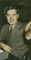 Author photo. 1935 cigarette card of Sen. Huey Long (Courtesy of the <a href=&quot;http://digitalgallery.nypl.org/nypldigital/id?1588819&quot;>NYPL Digital Gallery</a>) (image use requires permission from the New York Public Library)