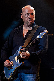 Author photo. Mark Knopfler with his Pensa MK D guitar live at Le Zénith / Photo by Sebastien.gross
