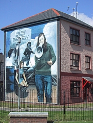 Author photo. wikipedia - A mural by the Bogside Artists in Derry's Bogside, depicting Devlin