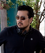 Author photo. Justin Lin on the set of Fast and Furious 6 in the Canary Islands, Spain / Joshua Henson