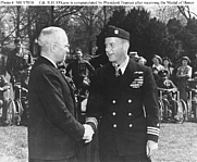 Author photo. O'Kane is congratulated by President Truman, after he had been presented with the Medal of Honor in ceremonies on the White House lawn, 27 March 1946. (Naval Historical Center)