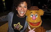 Author photo. Elise Allen with Fozzie Bear