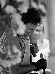 Author photo. Robert Butler demonstrating wood carving techniques at the 1965 State College Arts Festival in State College, Pa.
