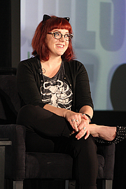 """Author photo. Victoria """"V.E."""" Schwab gives a presentation on the Genre Fiction Stage at the National Book Festival, August 31, 2019. Photo by Ralph Small/Library of Congress. By Library of Congress Life - 20190831RS0119.jpg, CC0, <a href=""""https://commons.wikimedia.org/w/index.php?curid=82899209"""" rel=""""nofollow"""" target=""""_top"""">https://commons.wikimedia.org/w/index.php?curid=82899209</a>"""