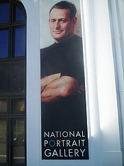 Author photo. National Portrait Gallery advertisement, Old Parliament House, London.  Photo by user Cfitzart / Wikimedia Commons.