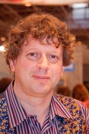 Author photo. Photo by Georges Seguin. Autograph session with Peter F. Hamilton at Salon du livre 2009 (Paris, France).