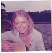 Author photo. Getting sun and playing the guitar on Herrington Lake, KY