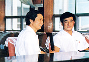 Author photo. Li Hongzhi (right) being interviewed in 1993
