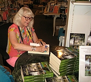 Author photo. Me signing WHIMSEY: A NOVEL at Quarter Moon Books, Topsail Island, NC