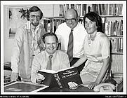 Author photo. Professor Arthur Delbridge, holding dictionary with, from left, David Blair, John Bernard and Sue Butler, 1981