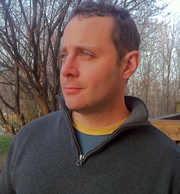 Author photo. Crime fiction author Matthew Iden on his back porch. There's a Bloody Mary in his right hand, but you'll never see it in the picture.
