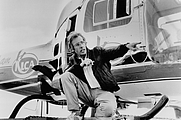 Author photo. Roger Spottiswoode in Air America (1990) / Photo by Carolco Pictures