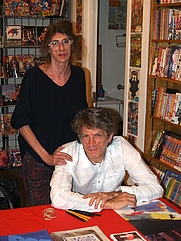 Author photo. Comics creators Marguerite Van Cook and James Romberger at a November 26, 2014 book signing for The Late Child at Jim Hanley's Universe in Manhattan. By Luigi Novi, <a href=&quot;https://commons.wikimedia.org/w/index.php?curid=37012015&quot; rel=&quot;nofollow&quot; target=&quot;_top&quot;>https://commons.wikimedia.org/w/index.php?curid=37012015</a>