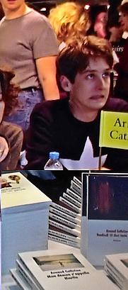Author photo. Arnaud Cathrine signing his books at Salon du Livre et de la Presse Jeunesse in Montreuil France Date 2001-12-03