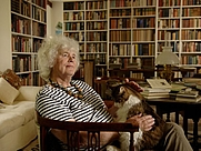 Author photo. Jan Morris, books and cat.