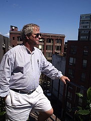 Author photo. Photograph of the author in a townhouse in the north section of Boston. Photo by Katelin Dutton.