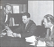 """Author photo. """"FBI-Washington"""" Program Director Harry Nelson (left), discusses research material with FBI exec Cartha D. DeLoach (center) as announcer Fred Foy looks on. (fbi.gov)"""